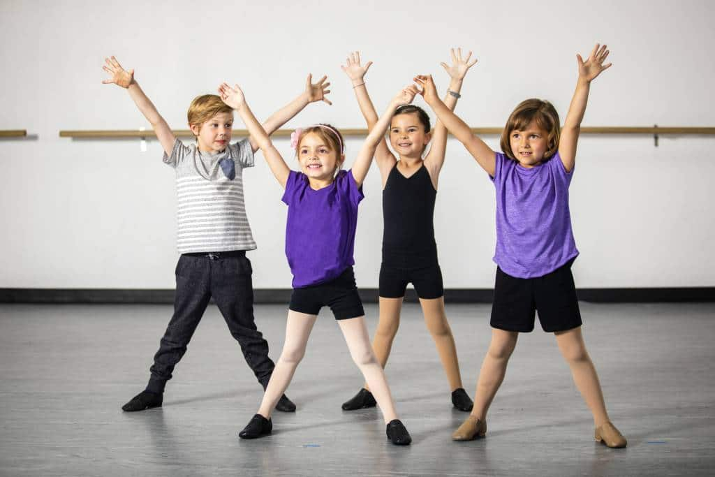 A cute group of children at Myriad Music & Dance Academy practicing a dance for Summer Family Week